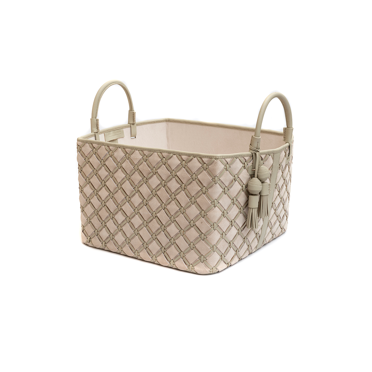Trancoso Geometrico Woven Leather Basket - Trancoso Geometrico Woven Leather Basket is designed to complement an ambient with natural and sophisticated feeling, ideal when placed next your sofa or bed, perfect for magazines and throws storage. Elisa Atheniense woven leather pieces, are handmade and manufactured in Brazil using an exclusive treated leather that brings the soft feel and touch to every single piece. Elisa Atheniense Home Baskets have a delicate tassel attached.   The basket is available in two sizes. Bespoke sizes are also available under project request as well as colours, see colour chart for reference. | Matter of Stuff