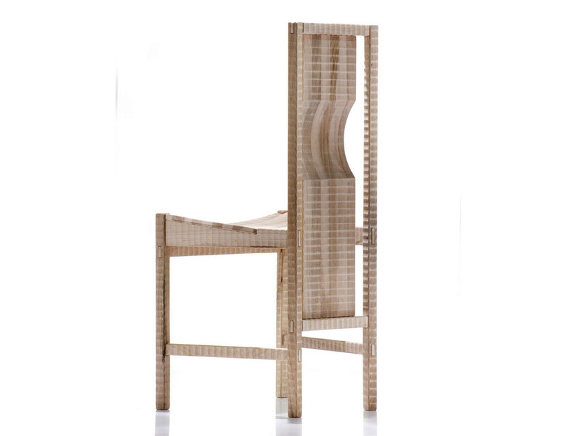"Pisana Chair - <p>Pisana is a chair with solid wood structure assembled by interlocking. Finished on all sides by plane and gouge. The entire manufacturing and finishing process is carried out manually in our workshop. The wood used for this piece is Juglans Regia – common Italian walnut; not dried but ""raw"". This wood belongs to the Latin tradition of furniture-making and features an extremely compact fibre which can, however, be worked without too much difficulty; it is therefore highly suitable for household items. Over time the wood hardens and becomes extremely resistant, and oxidises slightly to take on a progressively warmer amber colour. Customised and made with European cherry, Slavonian oak, maple.</p>