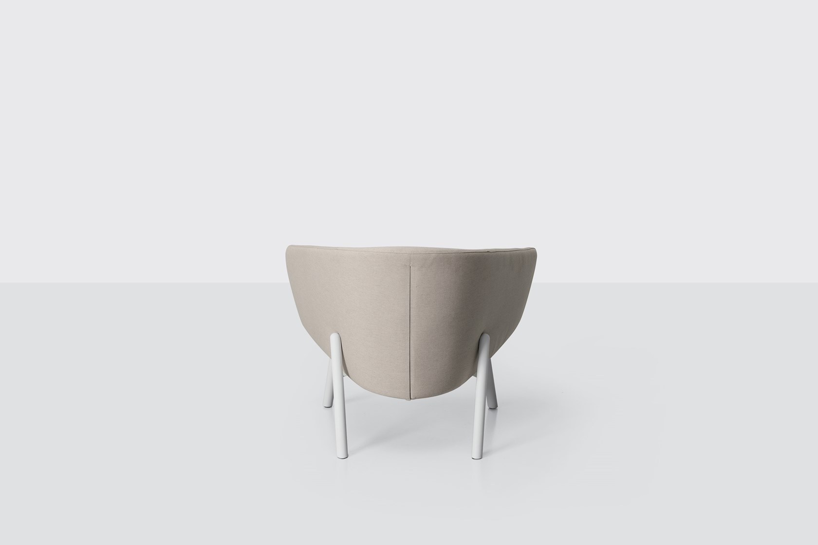 Tuile Armchair - <p>Tuile upholstered items take their name from the shape of the backrest and armrests reminiscent of the French biscuit of the same name. The style recalls homely atmospheres but they are made of materials specially designed for outdoor use. The frame is made of sturdy metal with anti-corrosion treatment and powder coating. Comfort is guaranteed with soft polyurethane foam padding, with a metal insert and straps, enclosed in a waterproof covering. The upholstery is made of Sunbrella® fabric: stain-resistant, breathable, resistant to UV rays and water-repellent.</p>  | Matter of Stuff