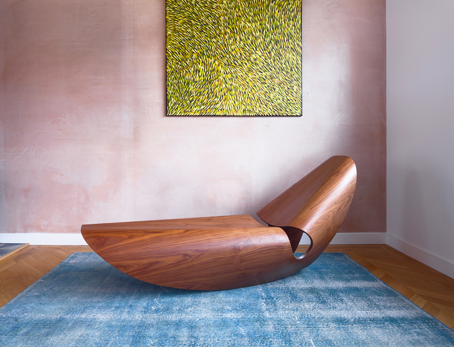 Cowrie Rocker - <p>The Cowrie rocker is inspired by the concave lines of sea shells. The curvilinear forms is the result of an extensive research and innovation process that bridges the handmade with the digital. Sweeping lines are displayed in a gentle, single surface monocoque fold. The all-in-one structure of the elegant rocking lounger is formed in bent plywood with either a natural or ebonised ash or walnut veneer.</p>  | Matter of Stuff