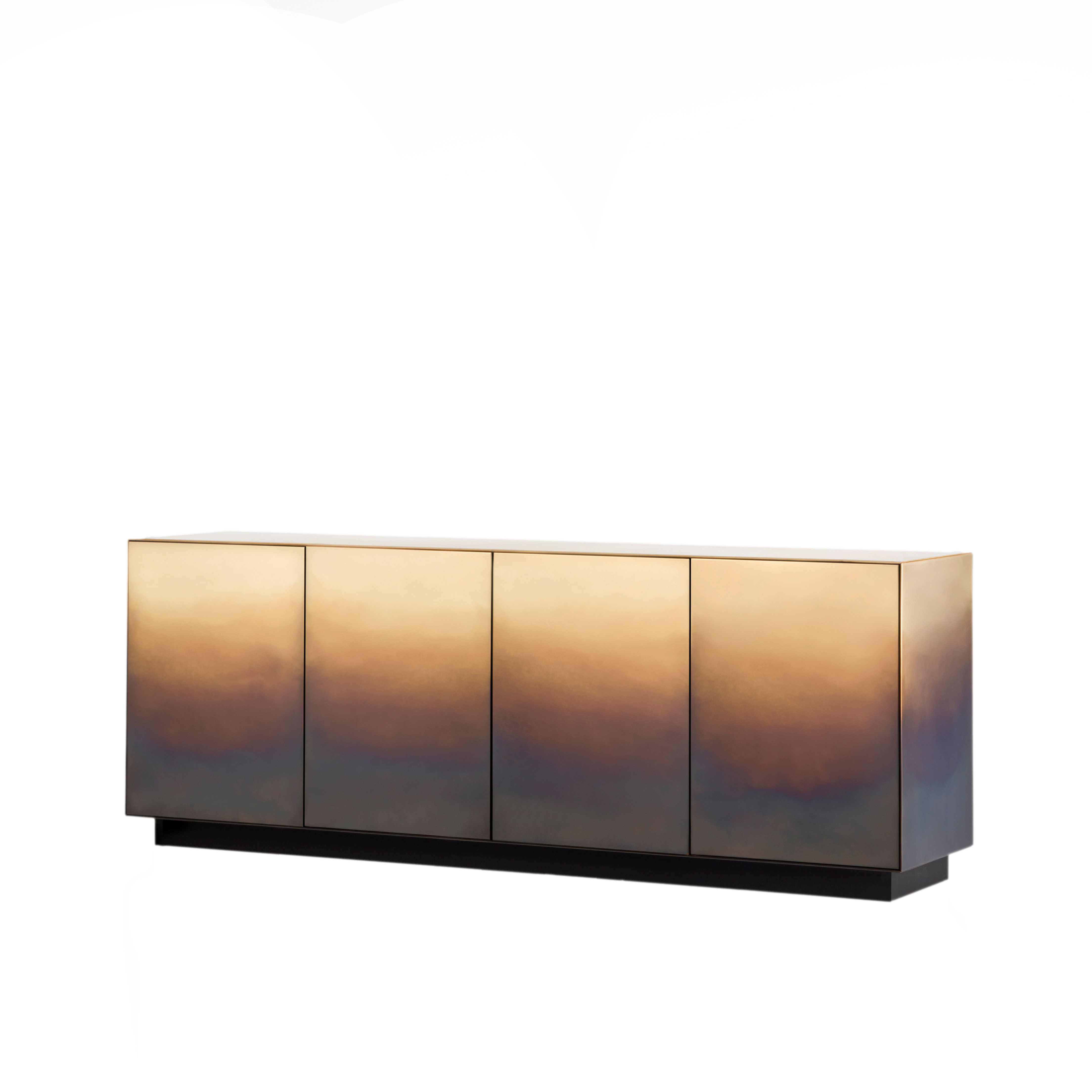 Marea Sideboard - The traces of time are drawn one on top of another, infused into the changing skin of the rigorous metal forms that define these cabinets and chests.‎ Like the tide (marea in Italian) leaves its mark, wave after wave, even here the hand of the craftsman has left its sign, oxidation after oxidation, creating a painterly effect that resembles water's erosion of the material.‎ Somewhere between design object and work of art, each piece in the collection, composed of a chest of drawers, low credenza and cabinet, is unique thanks to an entirely hand-crafted finish that transforms the metal surface into a delicate watercolour.‎