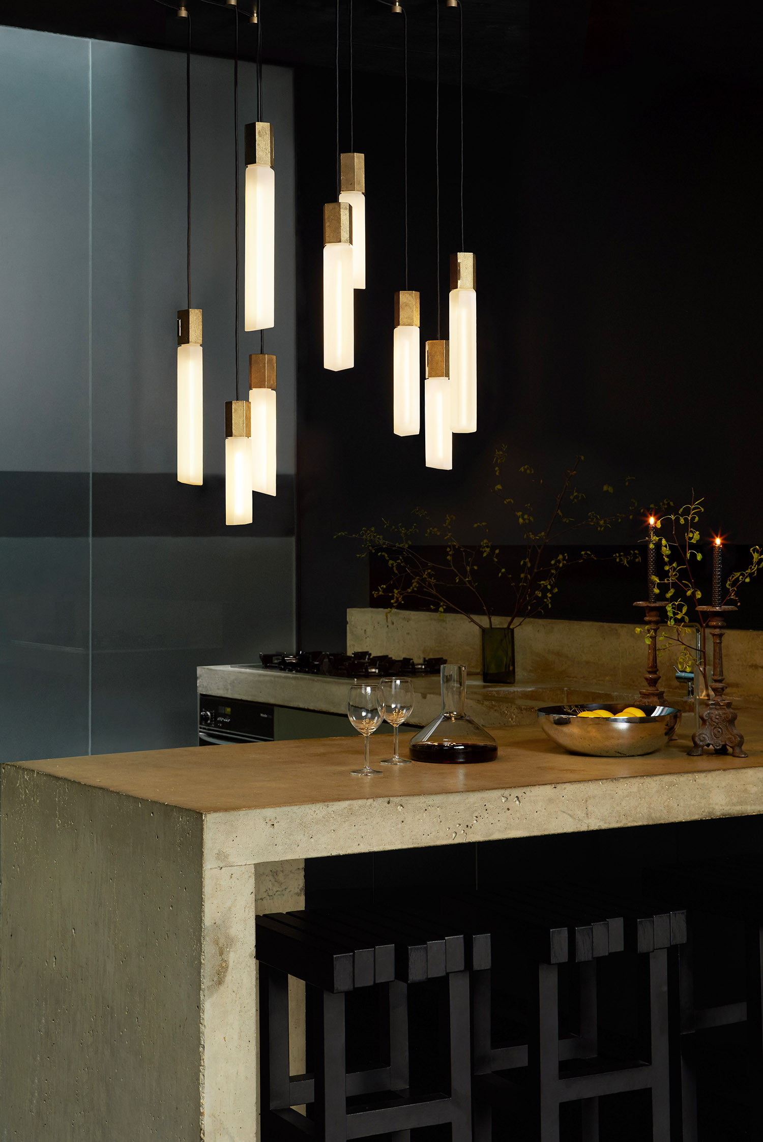 Basalt Ceiling Lamp Large - <p>Inspired by the thousands of extruded basalt columns that make up the Giant's Causeway, Basalt unites sand-cast solid brass and mouth-blown glass to evoke nature's magnitude. The Basalt Ceiling Light comprises three translucent matte borosilicate glass bulbs and textured pendants, each in their own dramatic size and length - suspended from an elegantly polished brass ceiling rose. </p> <p>15 Light Pieces.</p>  | Matter of Stuff