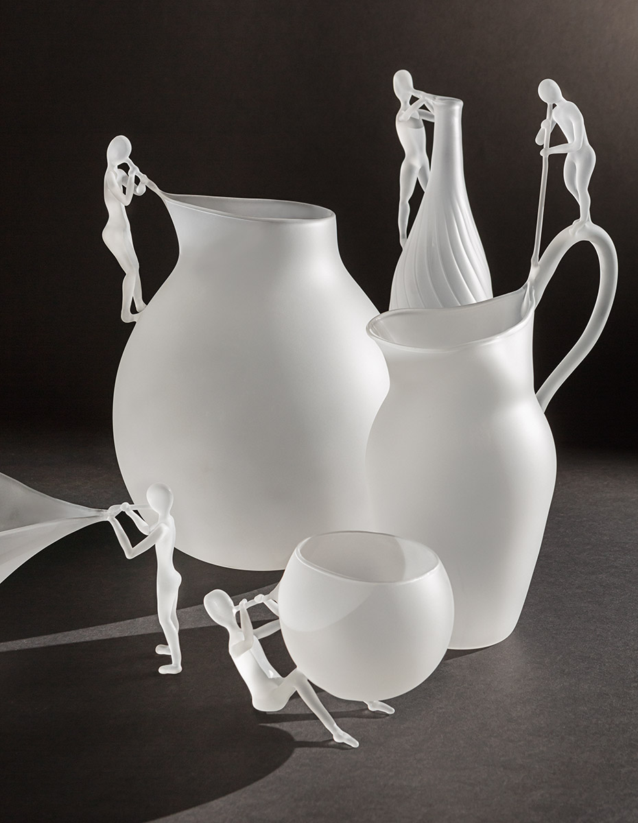 """The Blowing Man Vase - <p>The Blowing Man is a collection of 5 pieces in hand blown borosilicate glass in limited edition of 29 pieces, the story through the poetic and oneiric interpretation of the art of glass blowing.The collection becomes the theatre where """"man"""" is once again the protagonist together with the object, and through the object itself, in a game of light and shadows that highlight the high-end handwork through the poetry of gestures delicate like breaths.</p>  