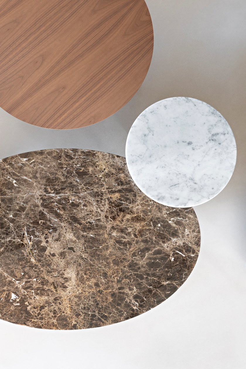 Hexa Round Coffee Table - Hexa is a round coffee table with marble top and 3-star base, available in two sizes.  The project takes its inspiration from the concept of our memory, reimagining simple and iconic forms with echoes from the past. Central to the design is the upright hexagonal structure typically used in building construction that, in this particular context, is interpreted as a joint onto which the feet are attached perpendicularly. This style detail is reminiscent of 1950's furniture design. The base of the table is painted finished metallic wire drawn and the top in marble.  Materials Structure in painted wire drawn with hexagonal section and feet in steel blade. Thickness top in 10 mm and with tapered edge. | Matter of Stuff