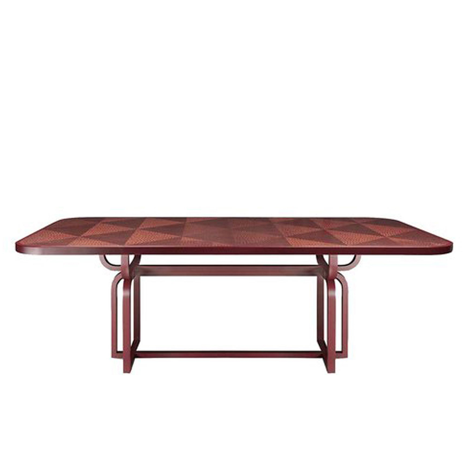 Caryllon Dining Table - The retro allure of this piece is conveyed by the square section of the structure, in striking contrast with the rich decorative treatment of its surface, the round corners at the top, and curved base. The top is adorned with a handcrafted straw inlay inspired by straw marquetry and tinted in vivid red, as in the Art Deco style. A homage to Michael Thonet, this solid wood table is available in two different heights.