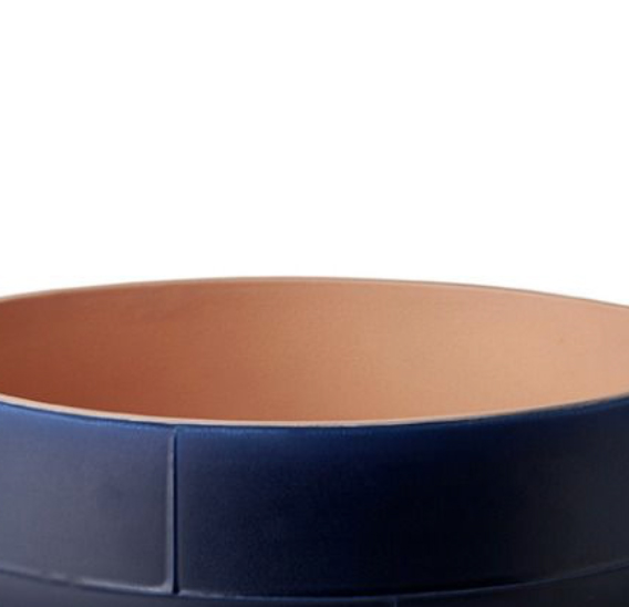 Two-Toned Bowl - Bowl. Cast in white clay. Two-tone matt glaze, orange on the inside and blue on the outside. Year of production 2014   Matter of Stuff