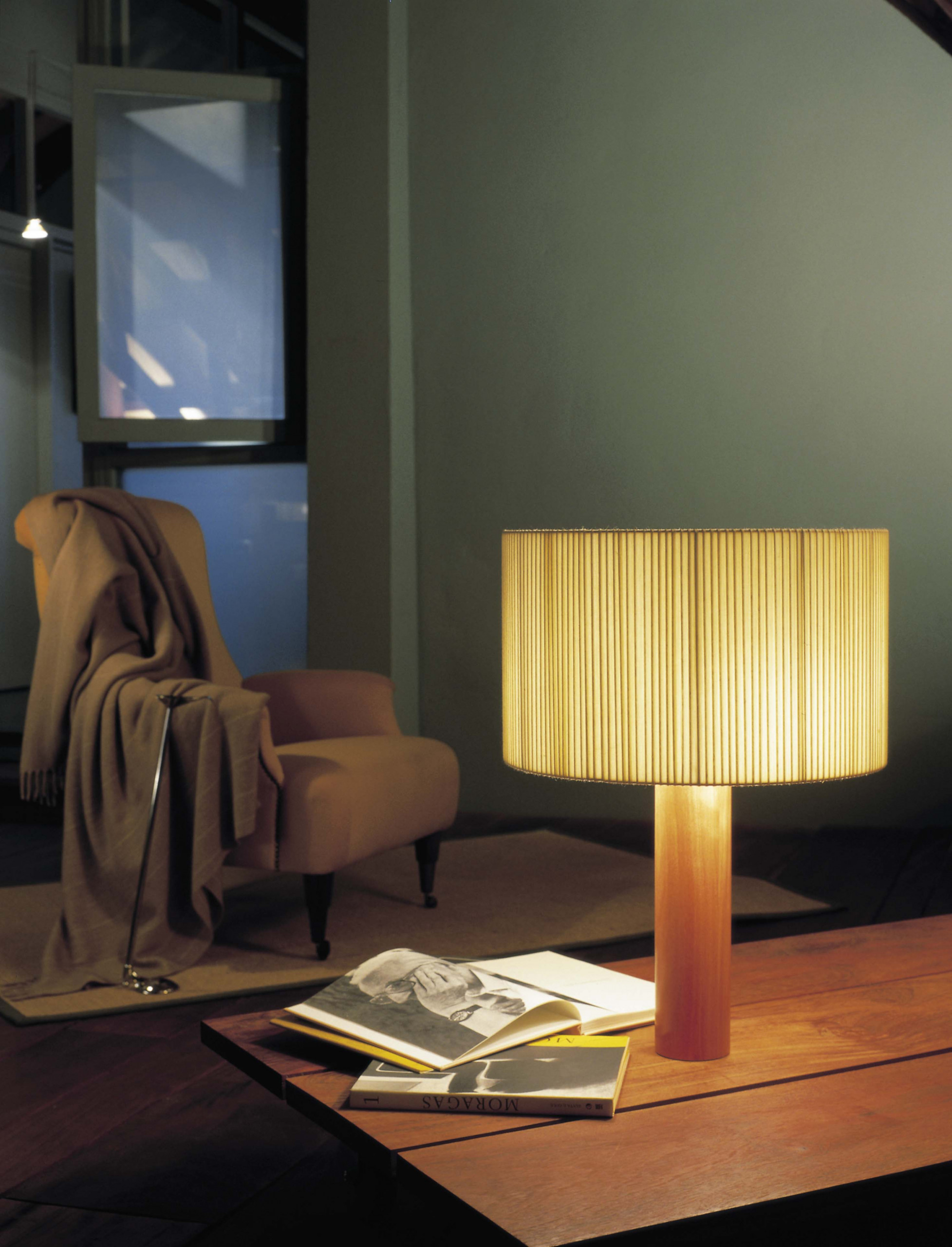 Moragas Table Lamp - <p>A sturdy wood cylinder supports a head with three bulbs arranged radially and outwards, surrounded by a generous circular shade. The shade is made from cotton ribbon (typically used for bookbinding) and has a silk thread running along the edge, forming an asymmetry that creates a splendid contrast of light and shadow.</p>  | Matter of Stuff