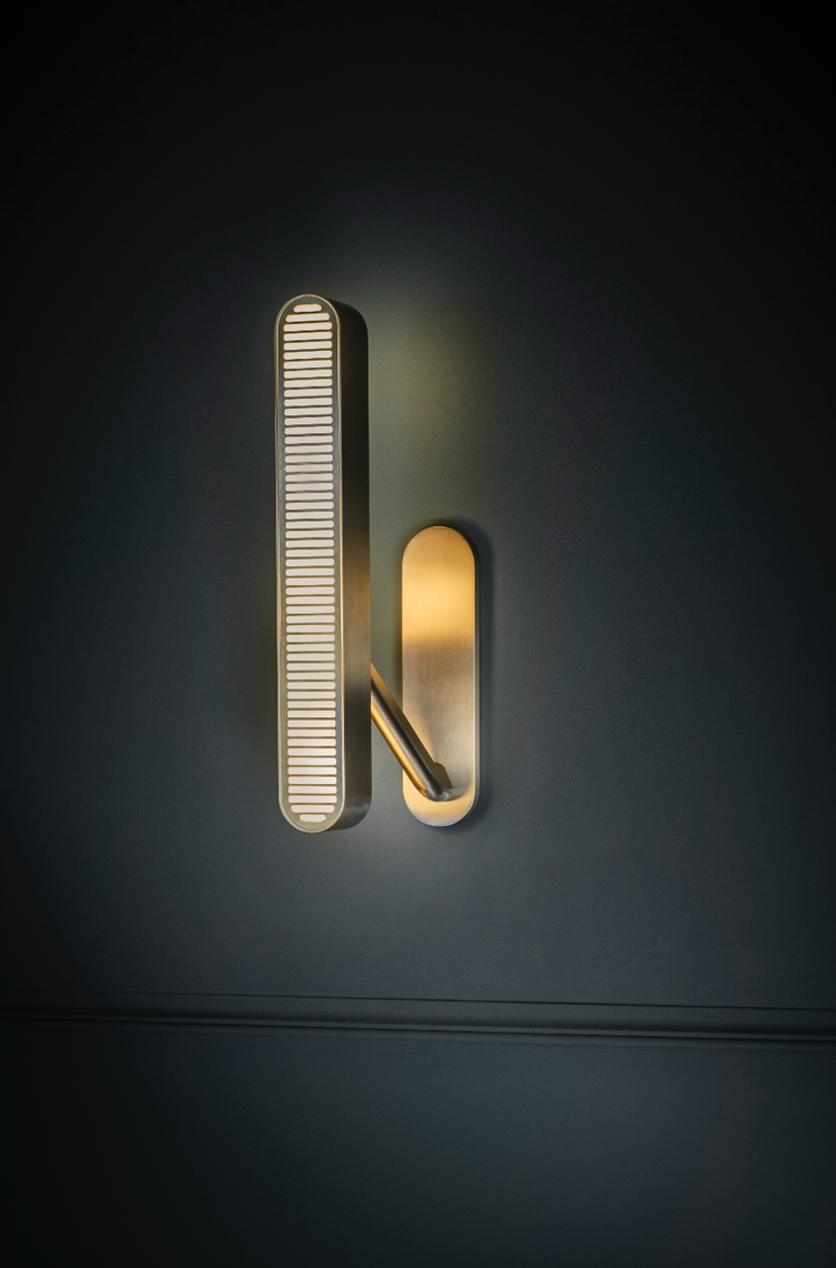Colt Wall Light - Single - <p><span>Crafted from machined brass, a sleek slotted grill sits atop an opal diffuser in Bert Frank's Colt Wall Light. With contrasting bronze inserts on the arm it casts a warm wash of light on both the wall and into the room.</p> <p></span></p>    Matter of Stuff