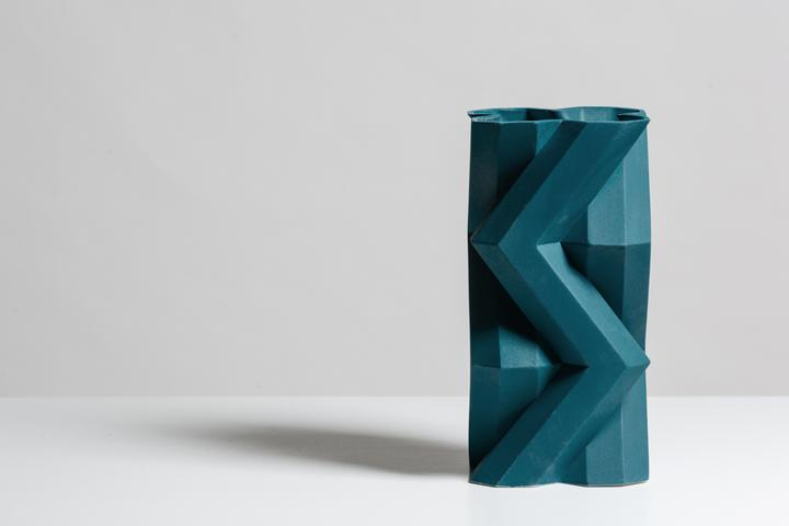 Fortress Tower Vase Blue - <p>Designer Lara Bohinc explores the marriage of ancient and futuristic form in the new Fortress Vase range, which has created a more complex geometric and modern structure from the original inspiration of the octagonal towers at the Diocletian Palace in Croatia. The resulting hexagonal blocks interlock and embrace to allow the play of light and shade on the many surfaces and angles. There are four Fortress shapes: the larger Column and Castle (45cm height), the Pillar (30cm height) and the Tower vase (37cm height). These are hand made from ceramic in a small Italian artisanal workshop and come in three finishes: dark gold, bronze and speckled white.</p>  | Matter of Stuff