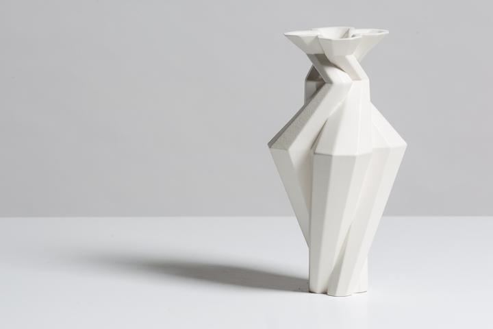 Fortress Spire White - <p>Designer Lara Bohinc explores the marriage of ancient and futuristic form in the new Fortress Vase range, which has created a more complex geometric and modern structure from the original inspiration of the octagonal towers at the Diocletian Palace in Croatia. The resulting hexagonal blocks interlock and embrace to allow the play of light and shade on the many surfaces and angles. There are four Fortress shapes: the larger Column and Castle (45cm height), the Pillar (30cm height) and the Tower vase (37cm height). These are hand made from ceramic in a small Italian artisanal workshop and come in three finishes: dark gold, bronze and speckled white.</p>  | Matter of Stuff