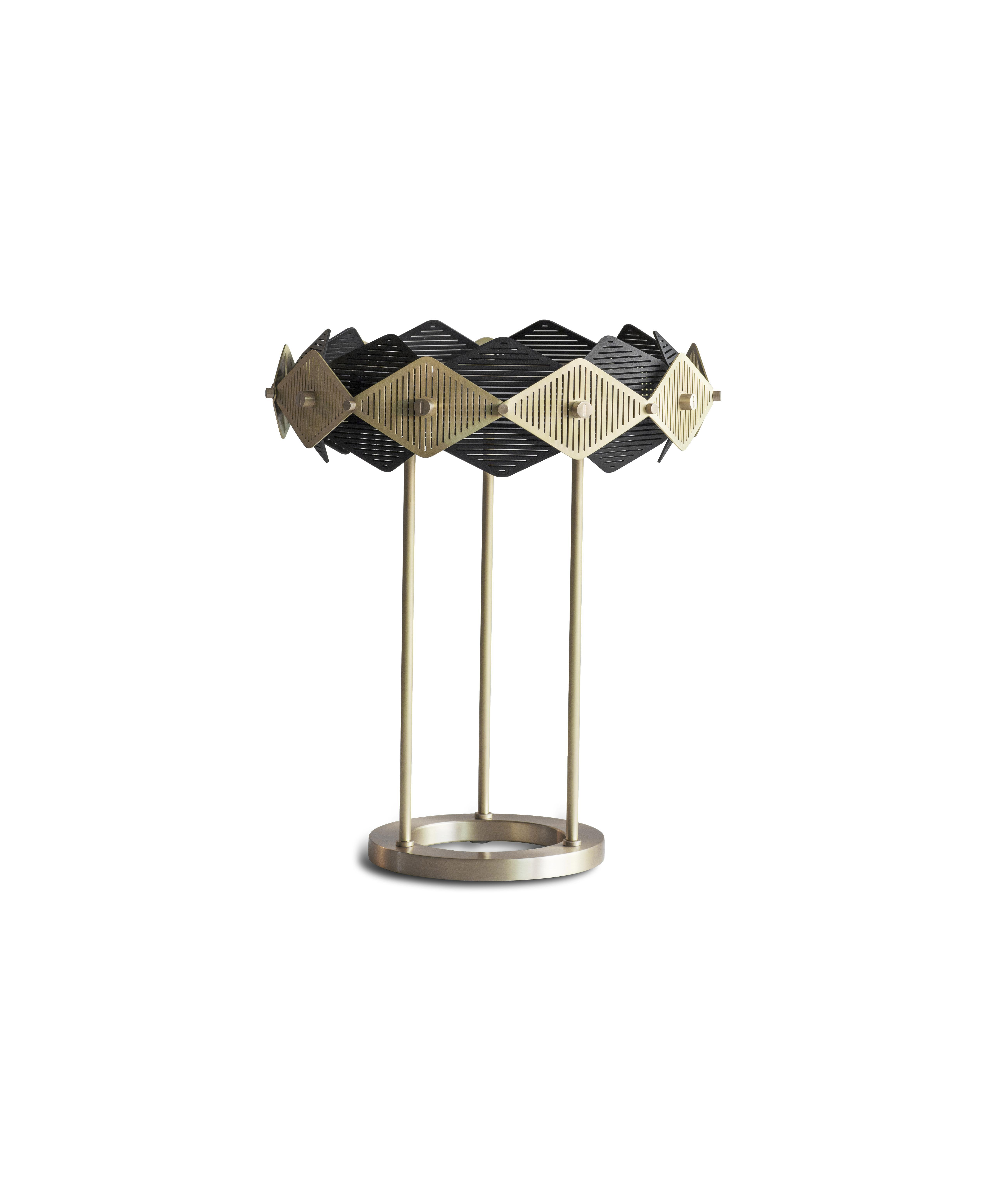 Rote Table Lamp - This intricate and petite version of the Rote shade is held aloft by three brass rod stems and fixed to a solid brass cylindrical base. Geometrically satisfying it demands attention.    Matter of Stuff