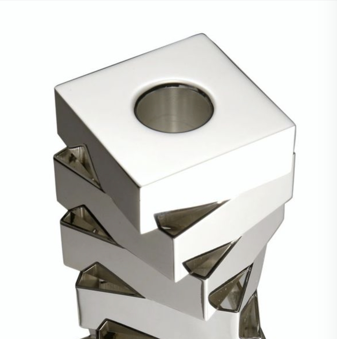 Vortice Candleholders - This Vortice candleholder is made of smooth glossy silver alloy.   Matter of Stuff