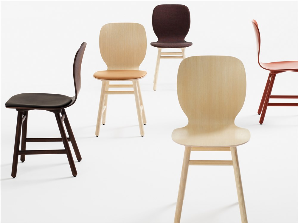 Shell Wooden Chair - The underlying thinking behind the design has been to find the right balance between the distinctive lines of the stool and a chair that projects its own unique identity. The aim has been to retain the subtle curves of the seat shell and the construction of the frame with its slightly angled legs. The chair provides a comfortable seating angle and an ideal degree of flexibility that follows the contours of the body and responds to its movements.  Depending on how you choose to combine seat shell, textiles and surface finish, you can change the personality of Shell to blend seamlessly into its surroundings. Such versatility means that Shell can be used in virtually any setting you wish. The chair makes a handsome match with many of Karl Andersson & Söner's tables and, thanks to its comfort and sleek lines, Shell is an ideal choice of chair in canteens, lunchrooms, restaurants and cafés. The chair is manufactured in oak, birch, ash, standard colours, standard stains on ash and white glazed oak or ash. Choose an all-wood chair or versions with a covered seat, or fully upholstered in fabric or leather. Cold-cured foam padding. Please enquire for details of other finish. | Matter of Stuff