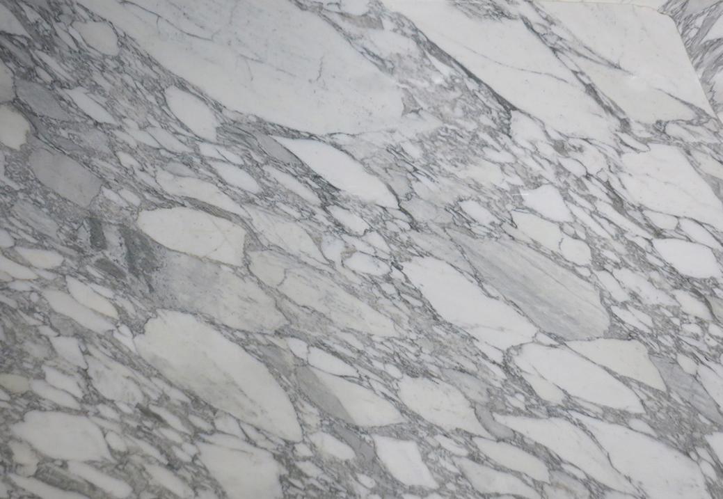 ARABESCATO VAGLI Marble - Sourced from our craftsmen quarries in Tuscany.Arabescato Vagli is a marble with an ancient history.Characterisedby a white background with light grey shades and pattern. <ul>  <li>Ultimate tensile strength (UTS) to pressure stress: 1.462 Kg/Cm2</li>  <li>Ultimate tensile strength (UTS) after freezing cycles: 1.260 Kg/Cm2</li>  <li>Ultimate tensile strength (UTS) to bending stress: 75 Kg/Cm2</li>  <li>Thermic linear dilatation 10-6 per °C : 9,4</li>  <li>Water absorption coefficient % in WeighT: 0,23</li>  <li>Weight per unit volume: 2.684 Kg/m3</li>  <li>Impact strength: 40,0 Cm</li>  <li>Module of linear elasticity: 406.000 Kg/Cm2</li>  <li>Abrasion strength: 8,14 mm</li>   Matter of Stuff